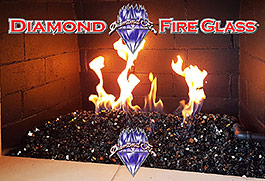 Black Reflective Nugget Fire Glass in an indoor fireplace
