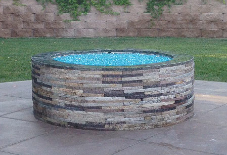 Bahama Blue Reflective installed in a fire pit with repurposed granite pavers